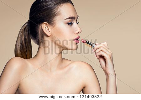 Charming young babe with lipstick