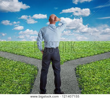 man standing at fork of road concept