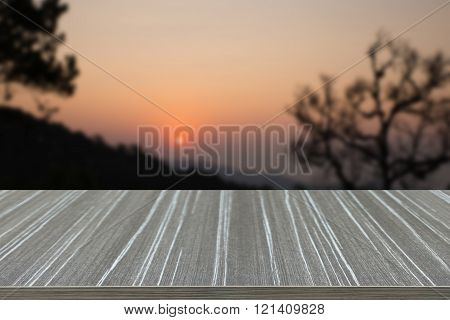 Empty Wooden Table With Sunrise And Mountain View Blur Background