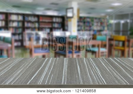 Empty Wooden Table With Book Shelf, Wooden Desk And Chair For Reading Book In Library Blur Backgroun