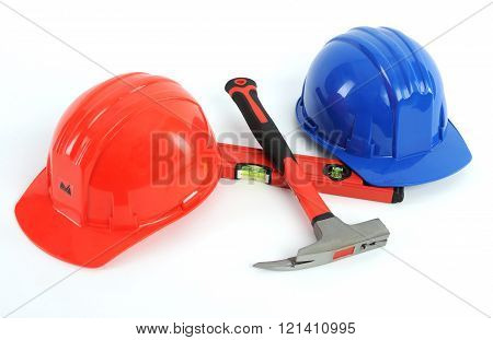 red and blue safety helmets isolated white