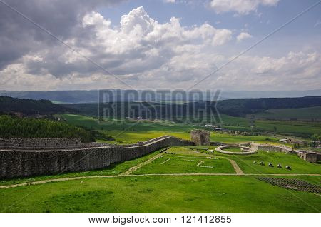 Spissky Hrad, Slovakia - May 12, 2013: Inside the walls of Spis Castle with panorama of meadows - Spissky hrad National Cultural Monument (UNESCO) ruins of medieval castle Slovakia