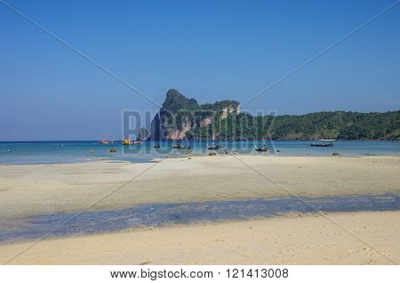 Beach Of Phi Phi Island In Low Tide With Bay And Longboat On Background, Krabi Province, Thailand
