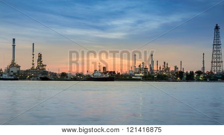 Panorama Oil refinery riverfront during sunrise