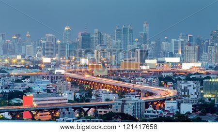 Twilight, highway curved and city downtown