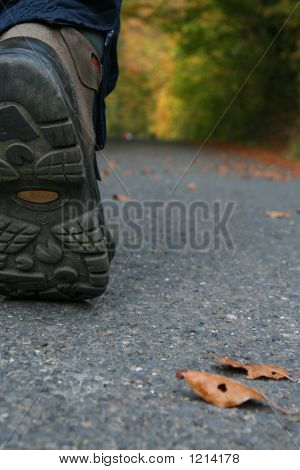 Hiking In Comfortable Boots On The Pavement In Fall.