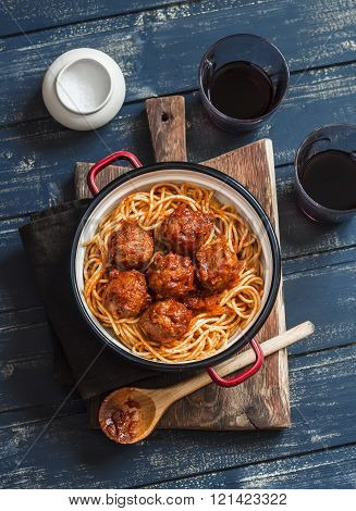 Spaghetti And Meatballs In Tomato Sauce And Two Glasses With Red Wine On Wooden Rustic Board. Delici