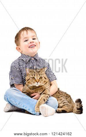 Cheerful boy hugging a cat Scottish Straight