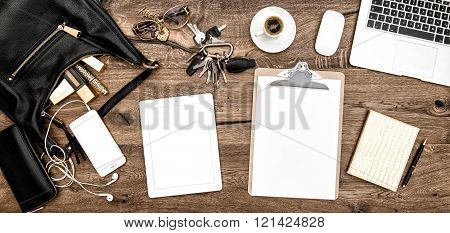 Feminine fashion mockup. Office desk with coffee office supplies cosmetics and electronic gadgets