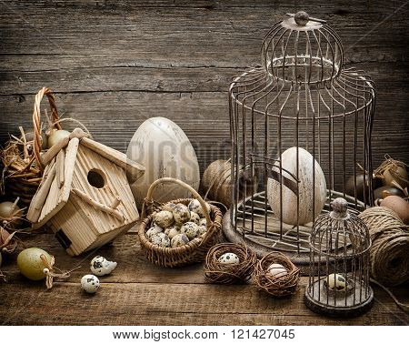 Easter Decoration With Eggs, Birdhouse And Birdcage