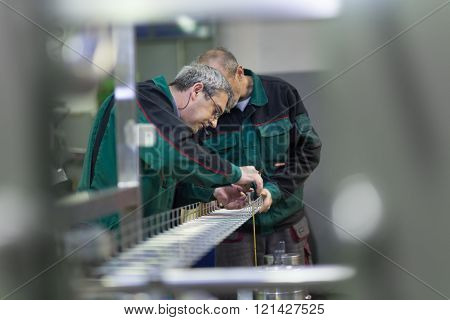 Industrial workers in manufacturing plant.