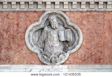BOLOGNA, ITALY - JUNE 04: Saint Paul by Giovanni Ferabech relief on facade of the San Petronio Basilica in Bologna, Italy, on June 04, 2015
