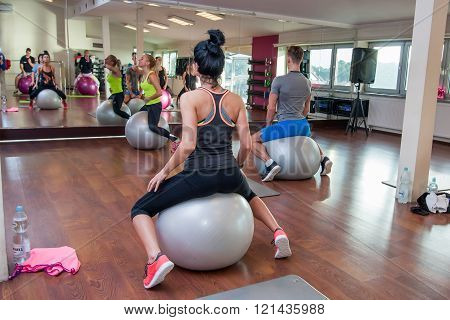 Otwock Poland - November 22 2015: The young people exercising fitness with huge balls