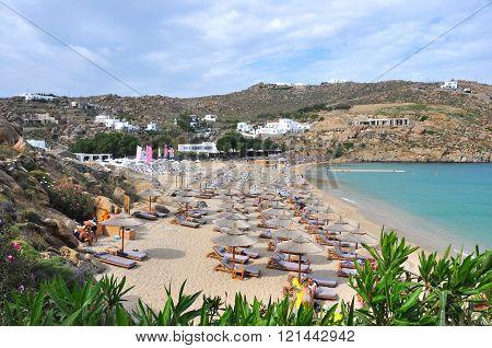 Mykonos, Greece - May 28, 2015: Beach in a bay on greek island Mykonos, in May 2015, with only few people on the beach