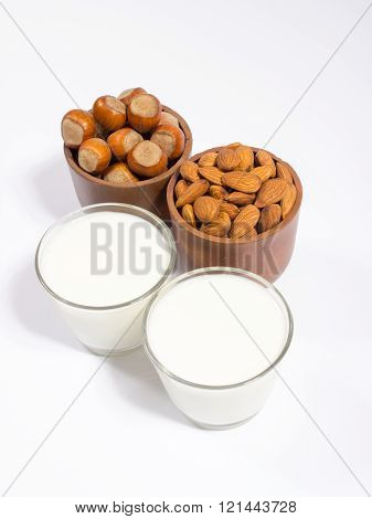 Glass Of Hazelnut Milk And Almond Isolated On White Background.