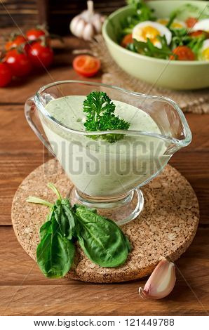 Fresh Green Sauce With Spinach On A Dark Background