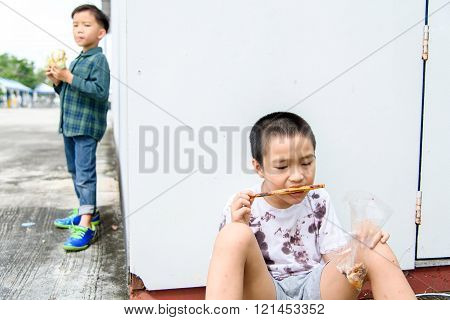 Boy Different Meal Eating Burger And Stick Food