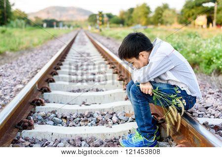 Boy Wating On The Railway