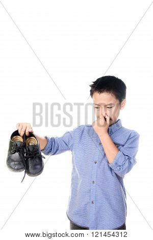 Boy Feeling Unhappy With Bad Smell White Sock