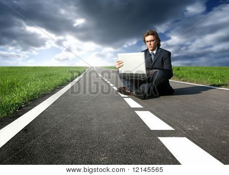 a man with a laptop on the street