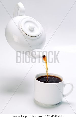 upside black coffee on white background