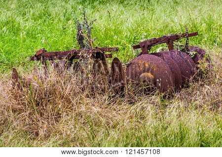 Very Old and Rusty Vintage Texas Farm Equipment Rusting in a Texas Field.