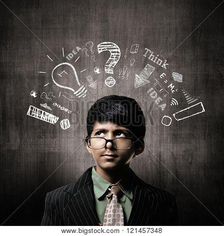Thinking Process. Genius Little Boy Wearing Glasses, Thinking Near Chalkboard