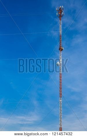 High-Tech Sophisticated Electronic Communications or Radio Tower Against a Blue Sky