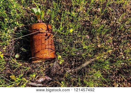 Old Discarded Rusty Tin Can in Field.