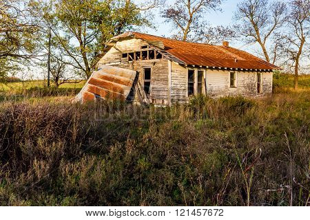 An Old Abandoned Oklahoma Farm House in Disrepair.