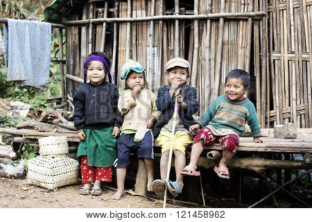 KANPETLET, MYANMAR - DECEMBER 9, 2015: Photo of a group of Chin tribe children. Chin people, also known as the Kukis are a number of Tibeto-Burman tribal people.