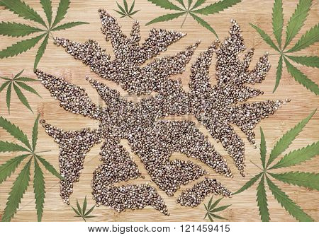 Hemp Leaves On A Wooden Bamboo Board And Hemp Seeds