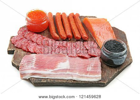 A set of smoked sausages, bacon and salmon  isolated on white