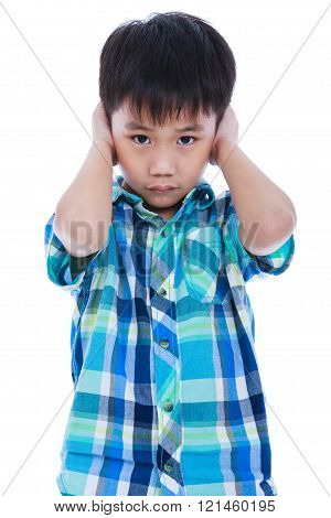 Asian boy covering his ear. Isolated on white background.