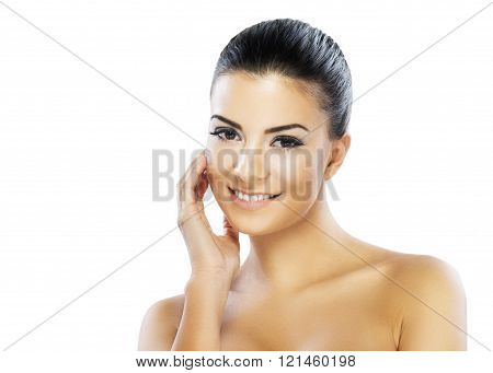 Close-up portrait of a beautiful woman looking at camera.Head and shoulders portrait of beautiful model on white background.