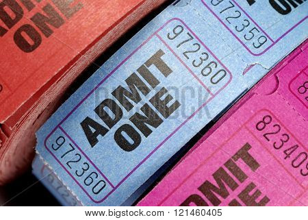Rolls of admit one movie tickets close up