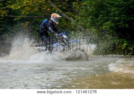 Motorcycle Enduro Moved Across The River In The Forest