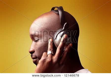 a profile of a man with a ear-phones
