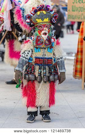 RAKOVSKI BULGARIA - FEBRUARY 06 2015 - Kukeri festival in Rakovski Bulgaria. People dressed in different costumes dance and preform rituals to scare the evel spirits.