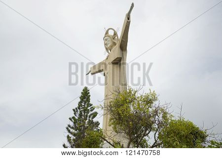 VUNG TAU, VIETNAM - DECEMBER 22, 2015: Statue of Jesus Christ in Vung Tau, on the background of cloudy sky. The main attraction of the city