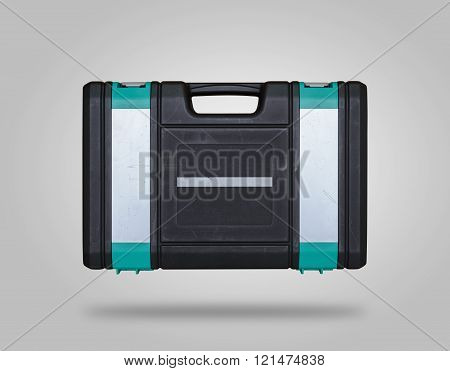 Closed scratched toolbox with shadow on gray background like icon