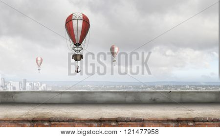 Aerostats flying over city