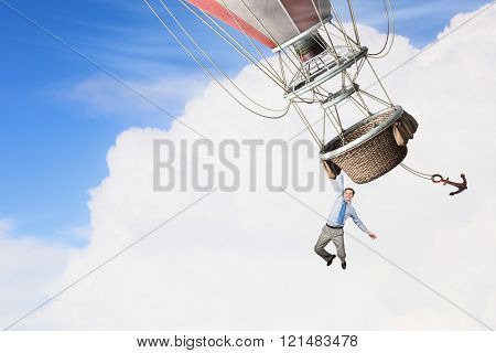 Man travel in aerostat