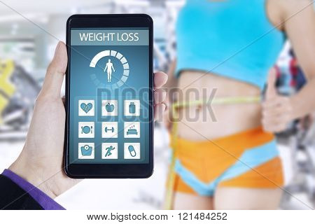 Health app and successful woman lose weight