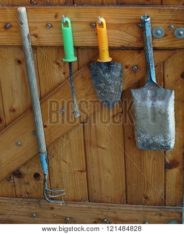 Old Garden Tools Hanging On A Wooden Wall, South Bohemia