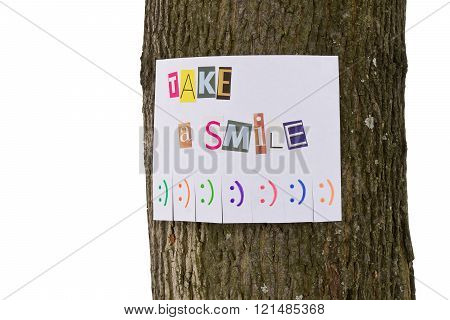A paper ad with the phrase: Take a Smile and with smile signs.