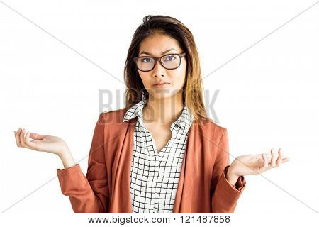 Doubtful businesswoman with eyeglasses on white background