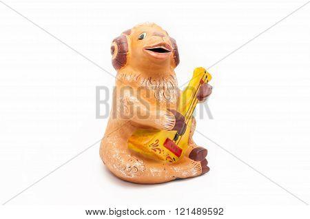 Piggy bank for coins , lamb playing the balalaika
