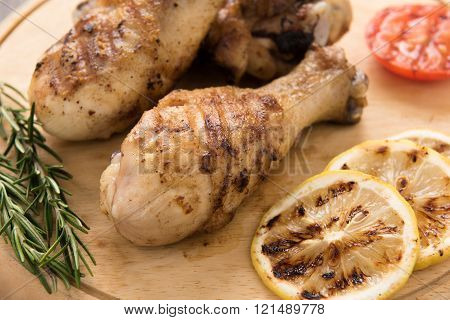 Grilled Chicken Drumstick On Wooden Background