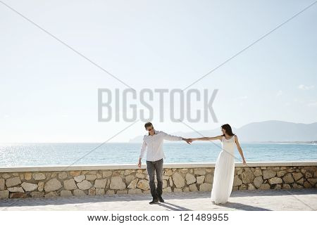 Couple Walking Together In Sperlonga, Italy